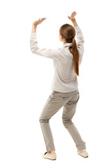 back view of woman  protects hands from what is falling from above. woMan holding a heavy load Rear view people collection.  backside view of person.  Isolated over white background. Skinny girl in
