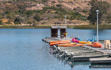 Small motorboat and kayak rental dock on rural lake