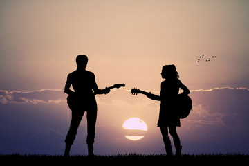 people with guitar at sunset