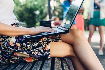 Closeup of girl using laptop