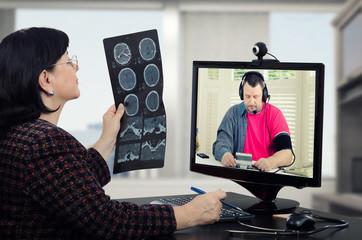 Man checks blood pressure in doctors monitor