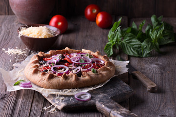 Baked Summer Vegetable open pie or Galette with Tomato, Aubergine, Garlic and cheese.