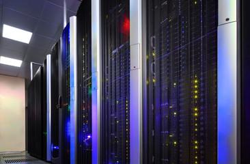 Fototapeta Data center full of server cabinets and racks