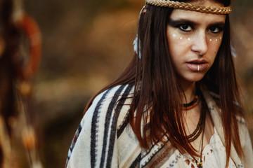 beautiful native indian american woman with warrior shaman make