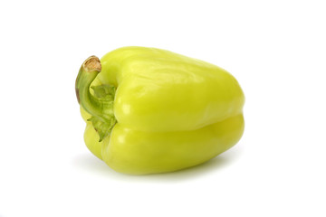 green sweet peppers on a white background