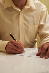 signing a contract at the table