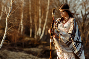 native indian american woman shaman on hill  in sunset evening m