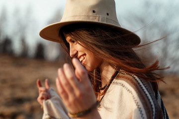 beautiful boho woman hipster portrait, smiling, wearing hat and