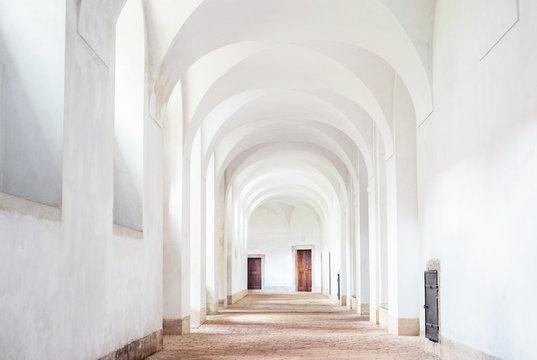 Monastery interior hallway cloister white clean archway, Plasy, Czech republic