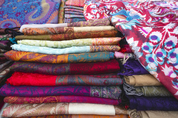 .Selling cloth shawls on a market in eastern Indonesia in Southeast Asia