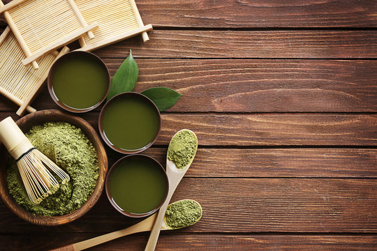 Fresh matcha tea on wooden background