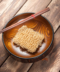 Instant noodles in bowl on wooden,Top view
