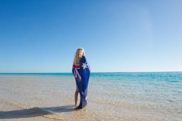 Relaxed woman Australian flag at beach