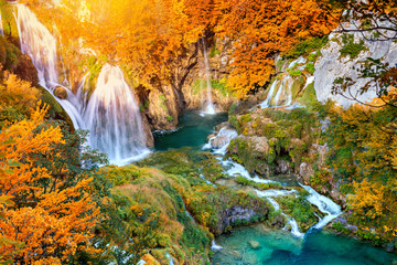 Autumn landscape with picturesque waterfalls