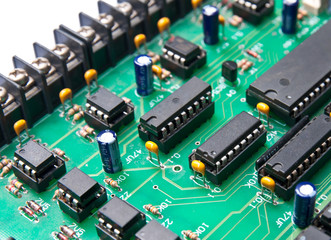 Closeup of electronic circuit board with processor, selective fo