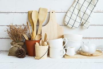 Kitchen cooking utensils on a shelf