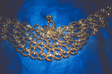 Golden Necklace on Blue Background Retro