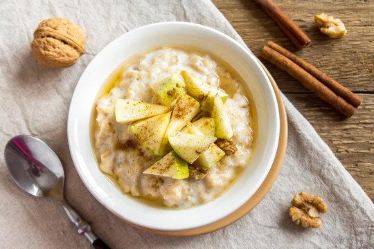 oatmeal porridge with apples, honey, nuts and cinnamon