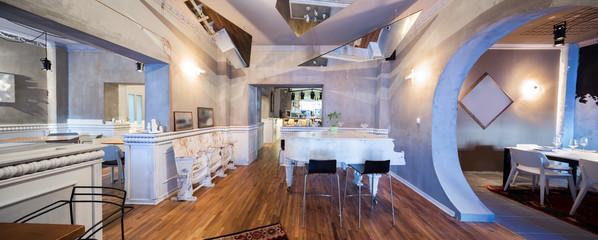 white piano in restaourant interior