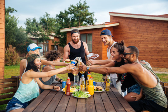 Happy young people celebrating and having outdoor party