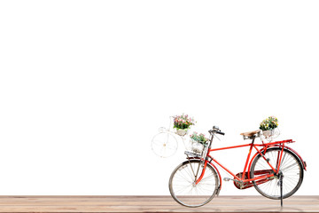 Old red bicycle with flower in basket on wood , white background