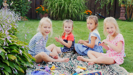 Children playing in the yard. Four little girls