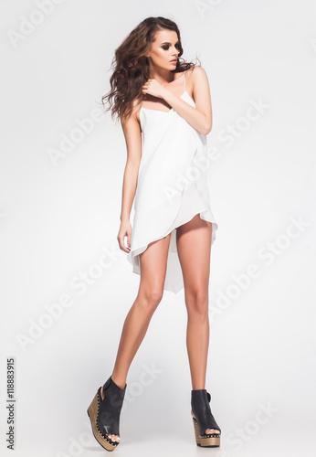 c51f17ec4a full body of beautiful woman model posing in white dress in the studio