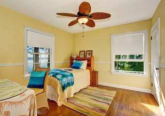 Craftsman bedroom interior with hardwood floor and rug.