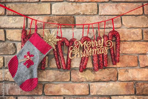 diy christmas decoration hanging against brick wall