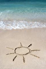 Hand drawn shining sun on beach sand