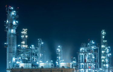 Oil Refinery factory at twilight , petrochemical plant , Petroleum , Chemical Industry.