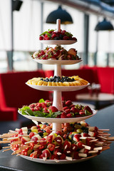colorful fruit and berries pyramid