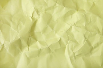 A full page of creased pale yellow craft paper texture