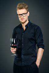 man with red wine