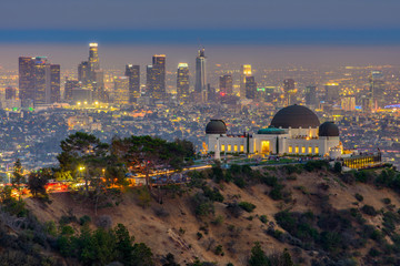 The Griffith Observatory and Los Angeles city skyline at twilight time