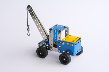 Tow truck, toy assembled with metal pieces