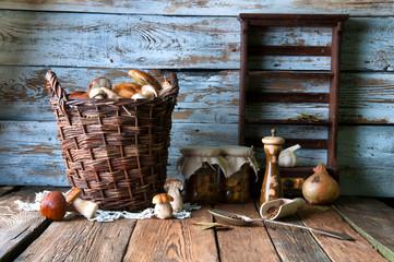 Fresh boletus in wicker basket in old rustic kitchen