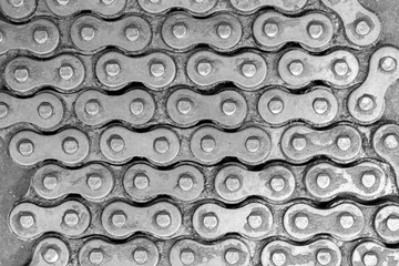 Chain background / Abstract background texture of old and dirty roller chain for motorcycle. Top view.