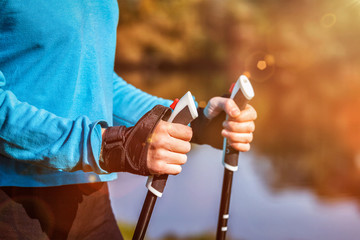 Closeup of woman's hand holding nordic walking poles