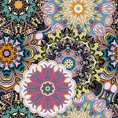 Vector seamless pattern with flowery mandalas print made in oriental style.
