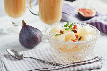 A delicious fresh melon and fig smoothie in a glass with a slice
