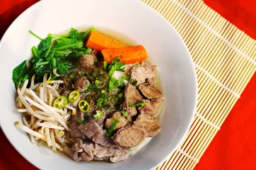 Delicious spicy rice noodle soup with pork and vegetables,original thai's fast food.