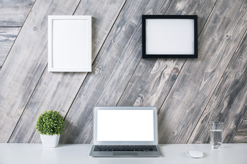 Creative workplace with picture frames