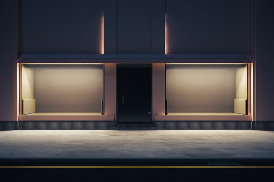 Empty storefront at nighttime