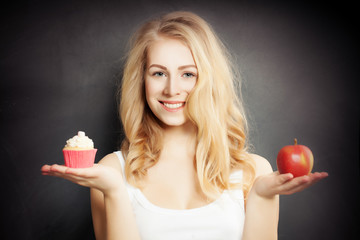 Diet. Healthy Woman Holding Red Apple and Cake