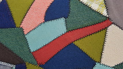 close up of upholstery crazy quilt pattern