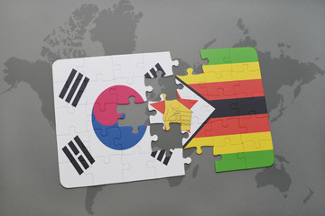 puzzle with the national flag of south korea and zimbabwe on a world map background.