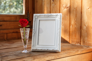 Photo frame and a red rose