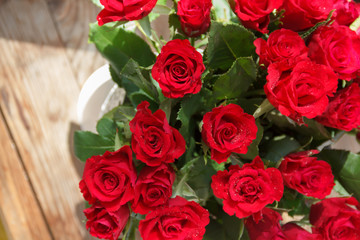 The bouquet of red roses in a vase