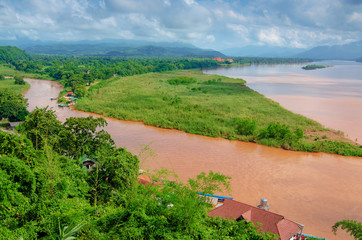 The region of the Golden Triangle, the view from Thailand to Burma. The Golden Triangle. Place on the Mekong River, which borders three countries - Thailand, Myanmar and Laos.